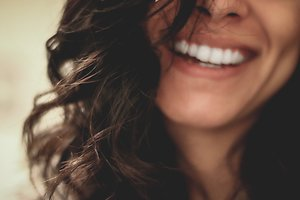 Home. Dark Haired Woman Smiling